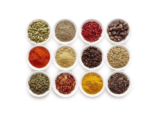Dried spices in small bowls, overhead view. — Stock Photo