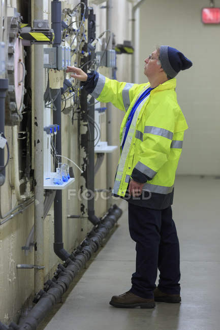 Water department engineer examining instrumentation panel. — Stock Photo