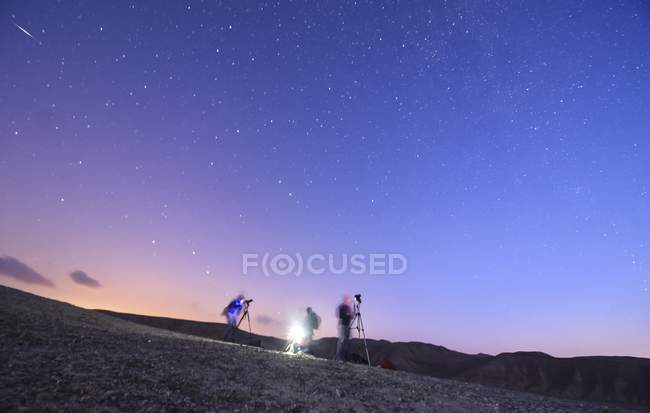 Scenic view of people stargazing in Negev desert, Israel. — Stock Photo