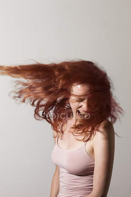 Angry woman with red hair screaming with rage. — Stock Photo