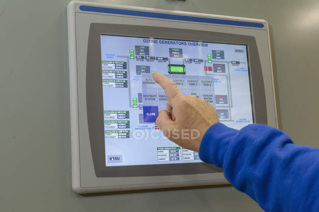 Male hand touching ozone generator control screen. — Stock Photo