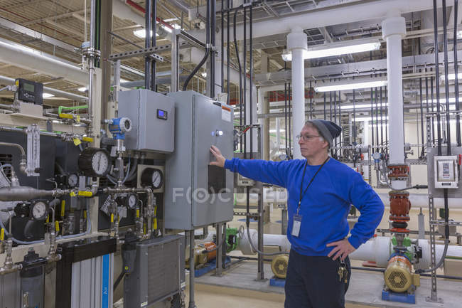 Water department engineer standing in chemical treatment room. — Stock Photo