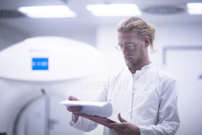 Radiologist checking notes in radiology room. — Stock Photo