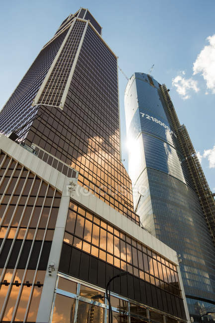 MOSCOW, RUSSIA - CIRCA AUGUST, 2015: Low angle view of Mercury Tower and skyscrapers. — Stock Photo