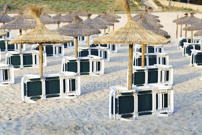 Sunbeds And Umbrellas On Sandy Beach Copy Space