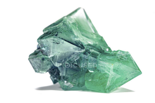 Green mineral gem on white background. — Stock Photo