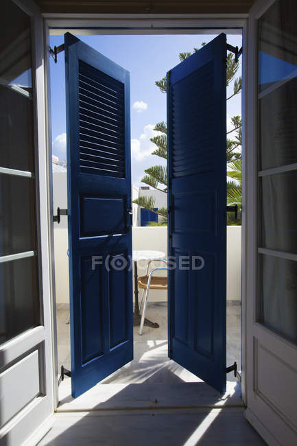 Shuttered door onto balcony of building in Santorini, Greece. — Stock Photo