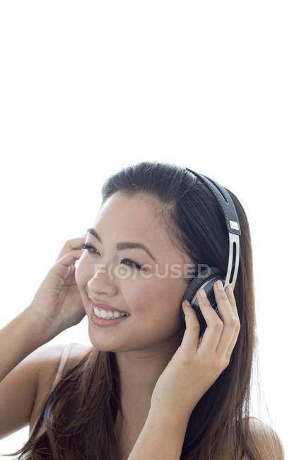 Young woman listening to music wearing headphones. — Stock Photo