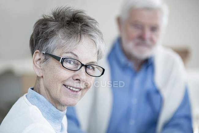 Senior woman in glasses smiling and looking in camera, portrait. — Stock Photo