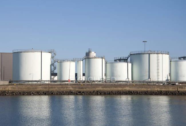 Storage tanks at oil refinery at shore in Danmark. — Stock Photo