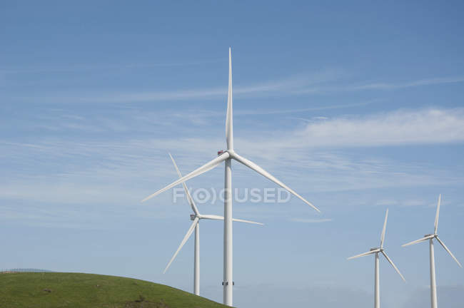 Rural scene of wind turbines against blue sky. — Stock Photo