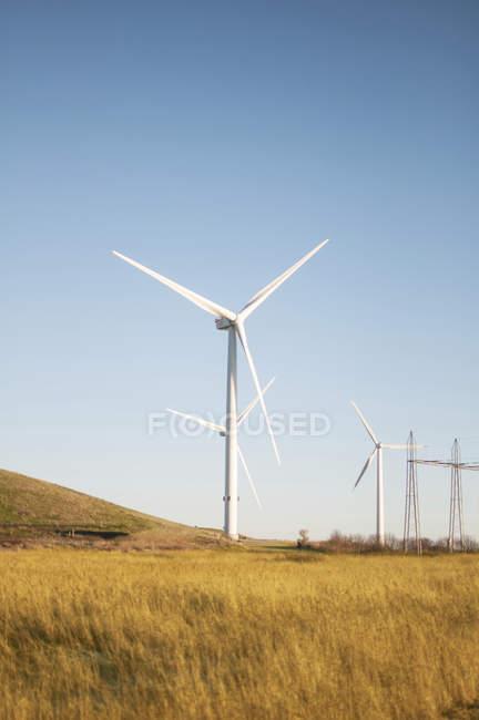 Rural scene of wind turbines against blue sky. — Stock Photo