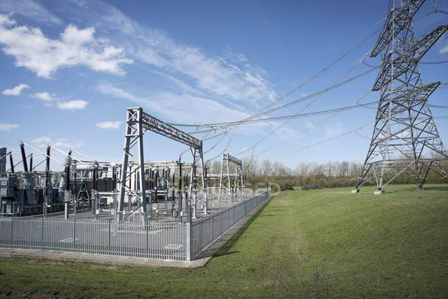 Electricity generating substation and connection to high voltage power lines. — Stock Photo