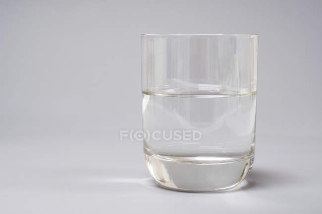 Glass of clean water on white background. — Stock Photo