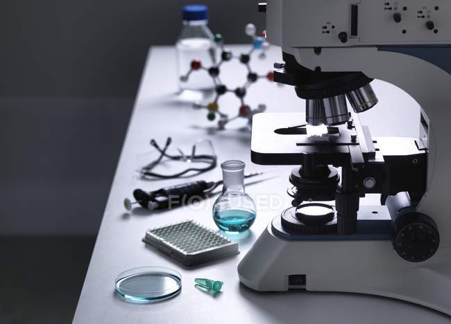 Still life of laboratory bench with microscope and various scientific equipment. — Stock Photo