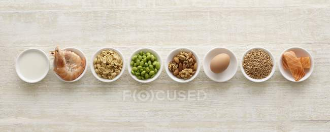 Various allergenic food in bowls, still life. — Stock Photo