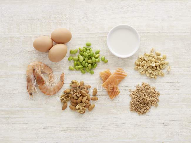 Various allergenic food on table, still life. — Stock Photo