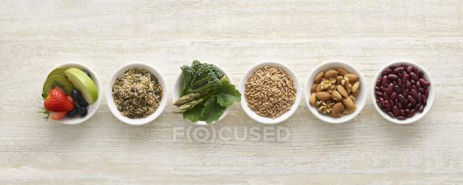 Top view of high fibre food in bowls, still life. — Stock Photo