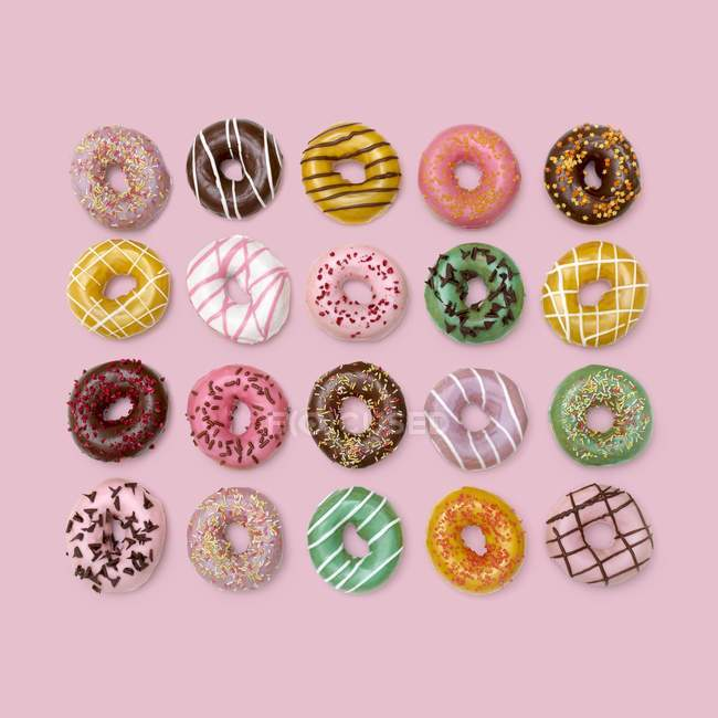 Top view of colorful donghnuts on background, studio shot . — стоковое фото
