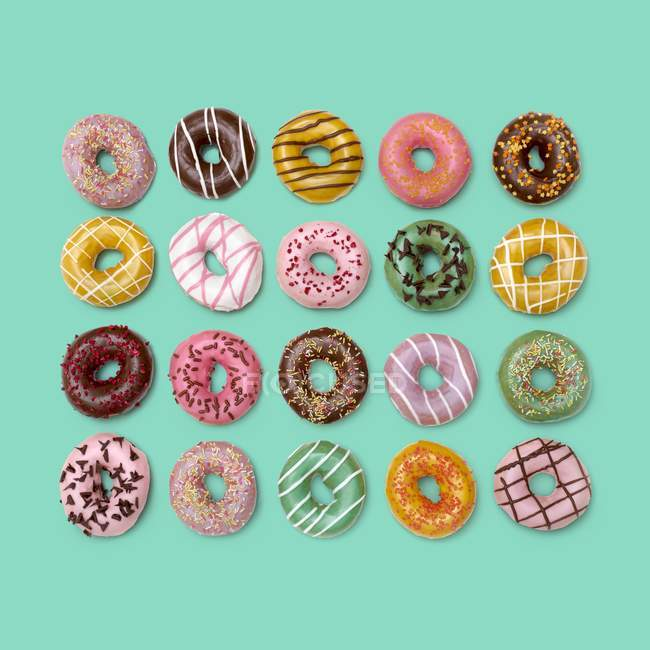 Top view of colorful doughnuts on background, studio shot. — Stock Photo