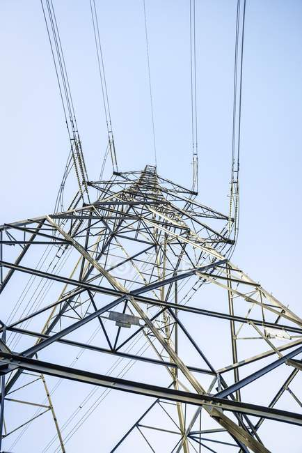 Low angle view of electricity pylon and power lines in North Wales, UK. — Stock Photo