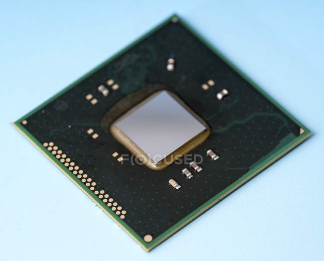 Silicon integrated chip on blue background. — Stock Photo