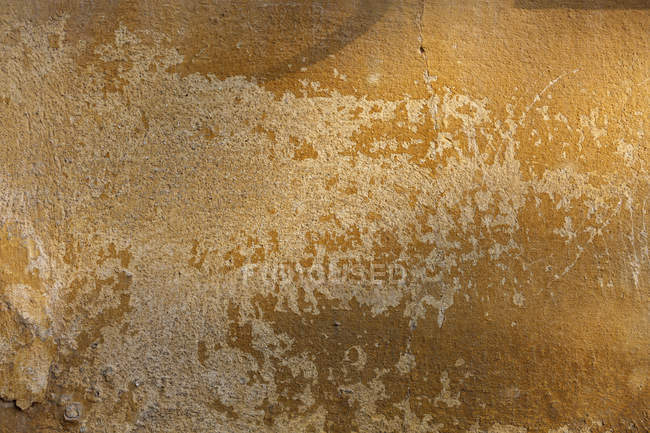 Brown weathered wall texture of building. — Stock Photo
