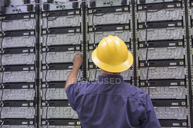 Engineer connecting energy storage batteries for backup power to electric power plant. — Stock Photo