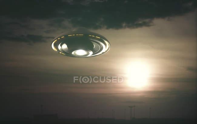 Alien space ship in sky at sunset, digital illustration. — Stock Photo