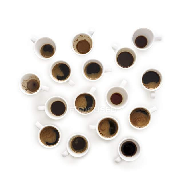 Cups of black aromatic coffee, top view. — Stock Photo