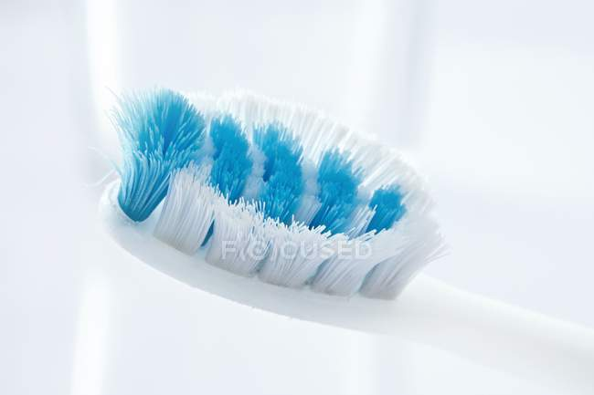 Close-up of used toothbrush against white background. — Stock Photo