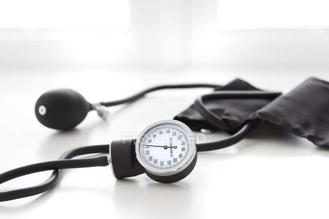 Blood pressure gauge on white background, studio shot. — Stock Photo