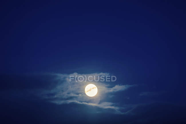 Scenery of dark night sky with full moon and clouds. — Stock Photo