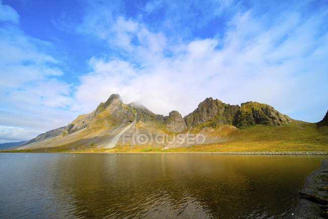 Coastal mountains under blue sky in Iceland. — Stock Photo