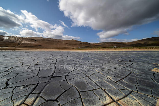 Cracked dried mud in hilly barren area of Iceland. — Stock Photo