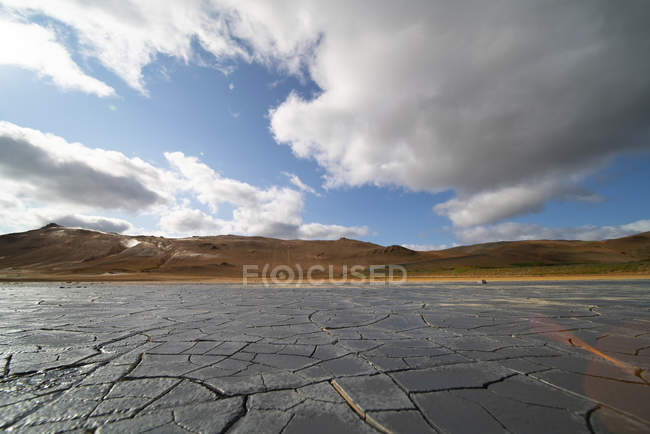 Cracked dried mud landscape in arid nature of Iceland. — Stock Photo