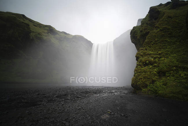 Fog over flowing water of Skogafoss waterfall, Iceland. — Stock Photo
