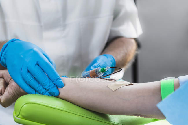 Close-up of doctor drawing female patient blood for PRP cosmetics treatment. — Stock Photo