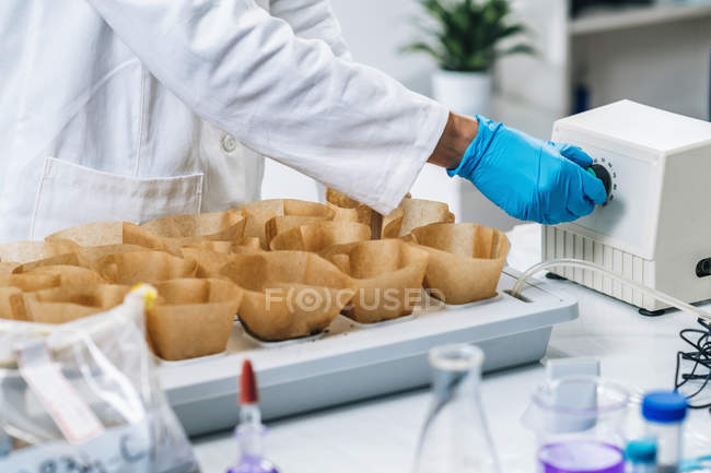 Close-up of examination of soil samples in agricultural laboratory. — Stock Photo