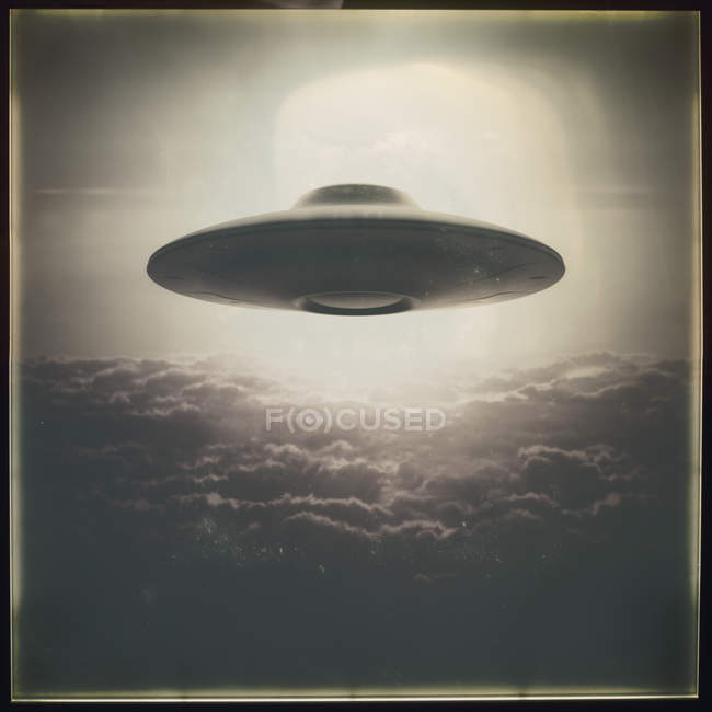 Vintage style UFO flying above clouds, illustration. — Stock Photo
