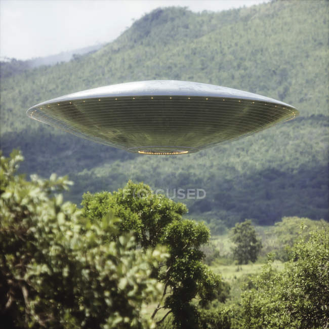 UFO flying above woodland trees, illustration. — Stock Photo