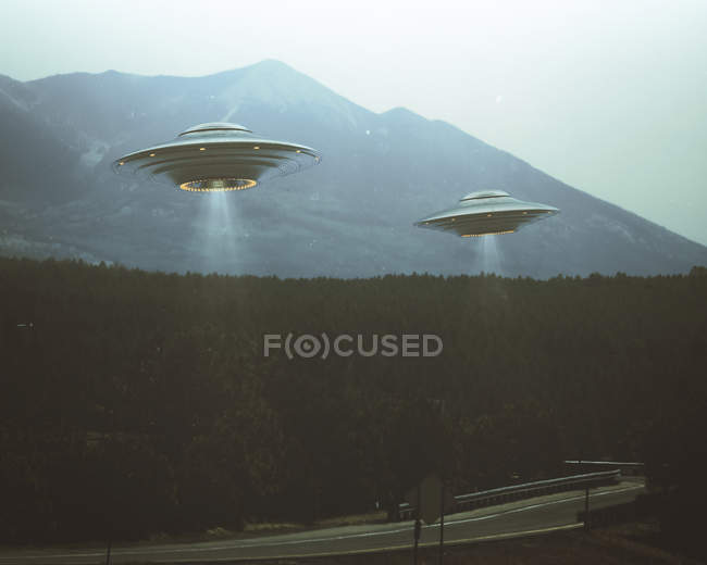 UFOs flying over highway and forest trees, illustration. — Stock Photo