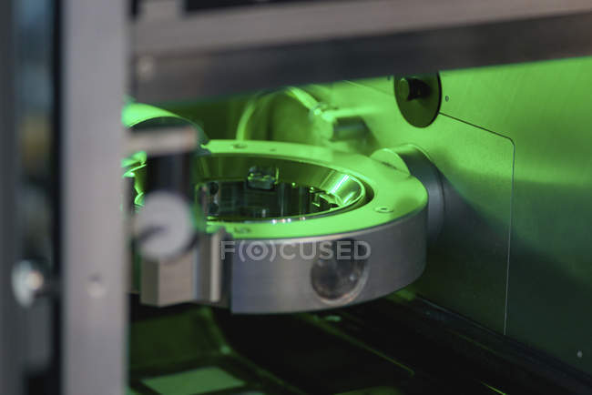 Dental CAD milling machine with green illumination, detailed. — Stock Photo