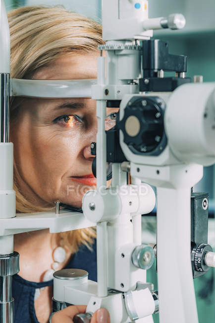 Female patient at eye test with slit lamp in ophthalmology clinic. — Stock Photo