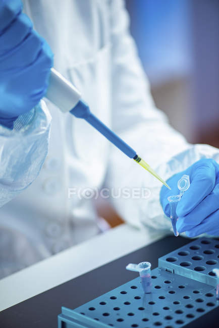 Female researcher using micropipette and tubes in laboratory, close-up. — Stock Photo
