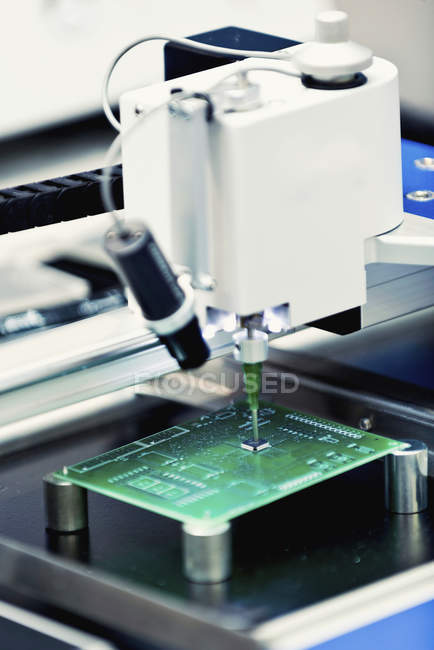 Printed circuit board manufacturing machine, close-up. — Stock Photo