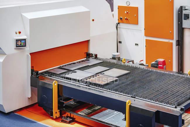 CNC servo drive turret punch press machine in modern industrial facility. — стокове фото