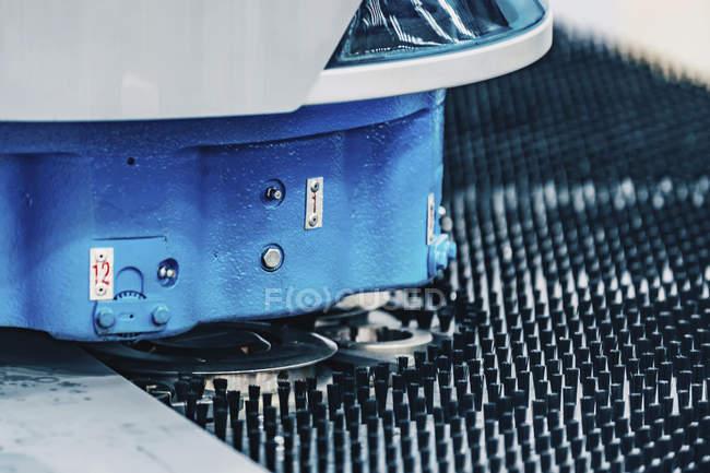 Flex hybrid technology punching machine in modern industrial facility. — стокове фото