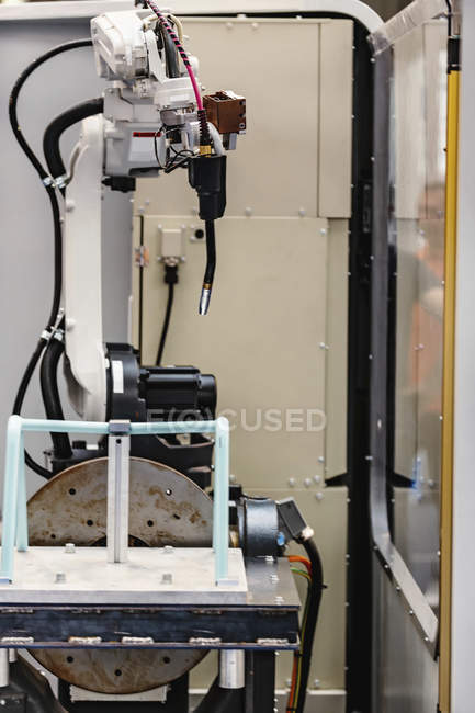 Robotic welding system in modern industrial facility. — стокове фото