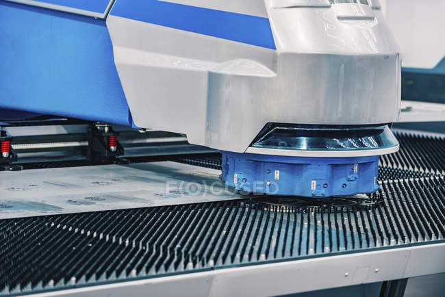 Flex hybrid technology punching machine in modern industrial facility. — Stock Photo